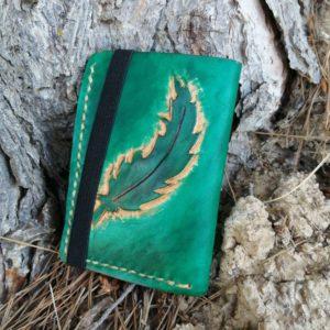 pluma turquesa cartera